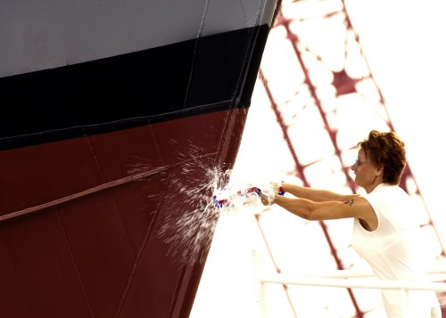 Why are ships christened with a bottle of champagne? photo