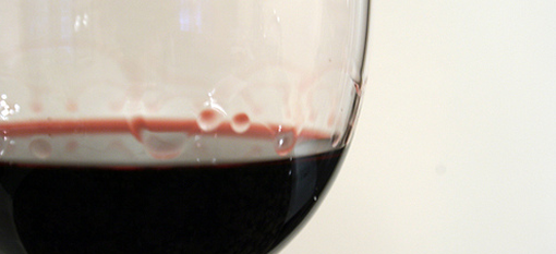 Slow-dripping wine legs photo