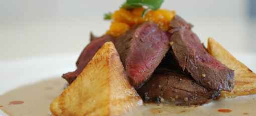 Roasted Springbok Fillet and oven baked potatoes photo