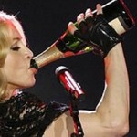 Material Girl downs bubbly on stage photo