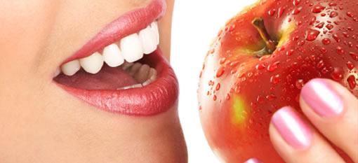 An apple is worse for your teeth than a fizzy drink photo
