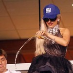 Lady Gaga Pours Champagne Over the Railing at a Sports Game photo