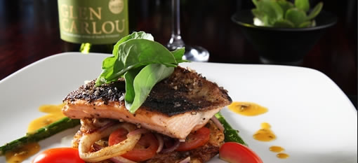 Salmon trout with ginger garlic crust served with seasonal vegetables photo