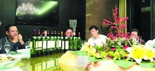 Inquiry gives ridiculous answer to boss` wine extravagance photo