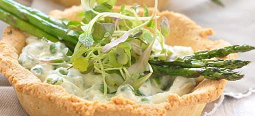 Tarts with goats cheese, asparagus and peas photo