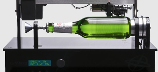 You can play this beer bottle like a record photo