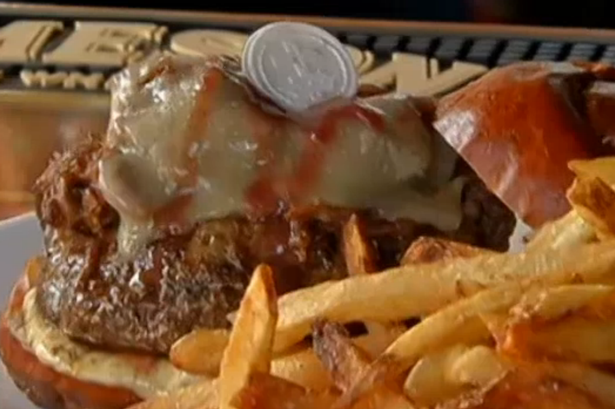 Unholy row as restaurant cooks up burgers topped with communion wafers and red wine sauce photo