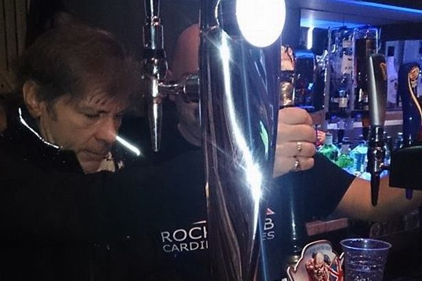 Iron Maiden legend Bruce Dickinson calls in at Cardiff bar… and starts pulling pints photo