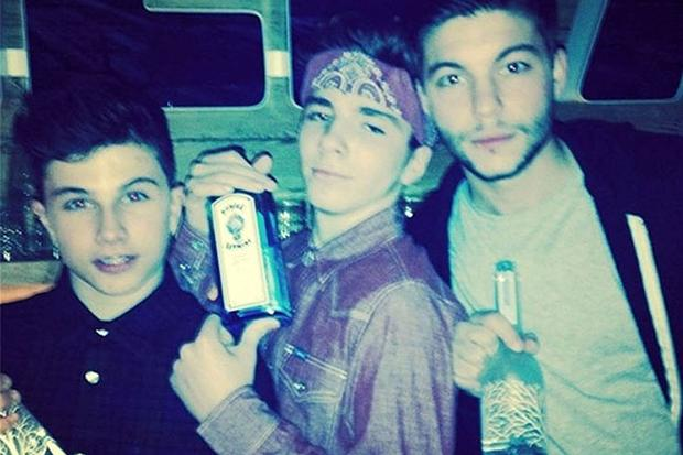Madonna Causes Controversy for Posting a Picture of Her Son Rocco, 13, Holding a Liquor Bottle photo