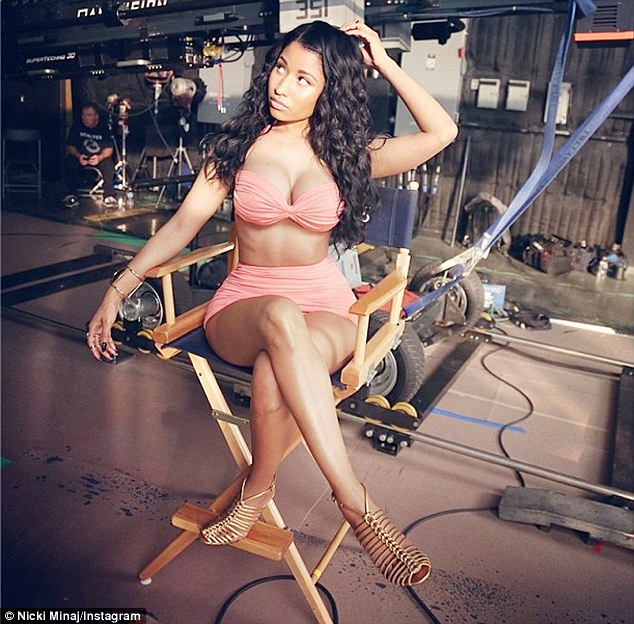 Nicki Minaj turns up the heat in designer lingerie for new wine commercial photo