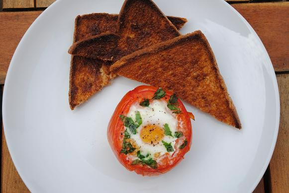 Eggs baked in roasted tomatoes photo