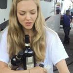 Amanda Seyfried juggles bottles of wine on the set of Ted 2 photo