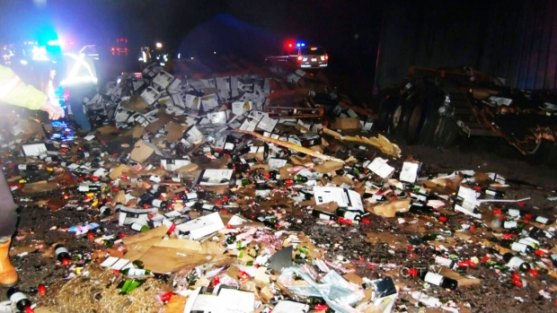 French truck spills 18,000 bottles of fine wine photo