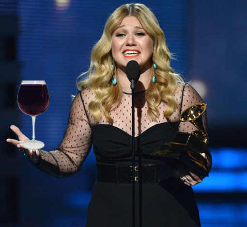 Cheers to that! Kelly Clarkson indulges in her first glass of wine in ten months photo