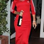 Rihanna can`t bear to waste a good wine! photo