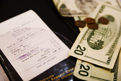 How much do you tip for a bottle of wine at a restaurant? photo