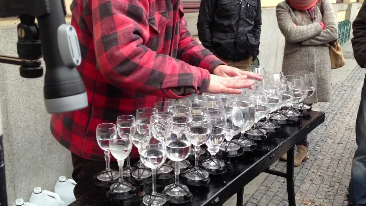 Street performer plays Leonard Cohen's Hallelujah on wine glasses photo