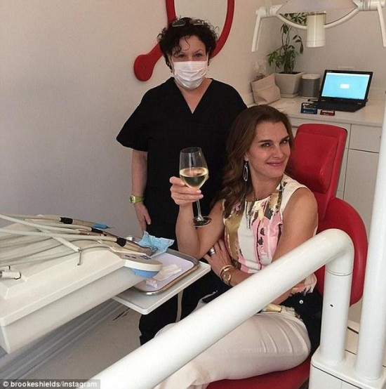 Brooke Shields raises full glass of wine as she visits the dentist to treat painful Bruxism photo