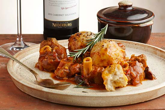 Lamb knuckles and dumplings with prunes, paired with Nederburg 56Hundred Cabernet Sauvignon photo