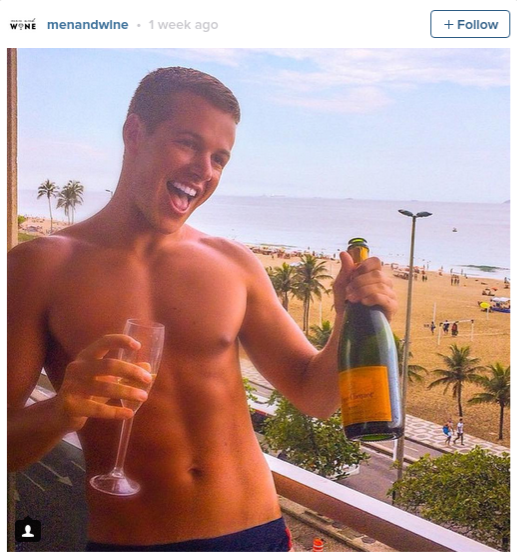 Check out this Instagram account featuring hot men drinking wine! photo