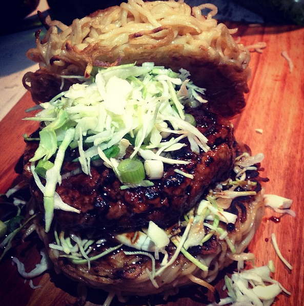 Teriyaki basted oxheart and tail burger in a ramen noodle bun photo