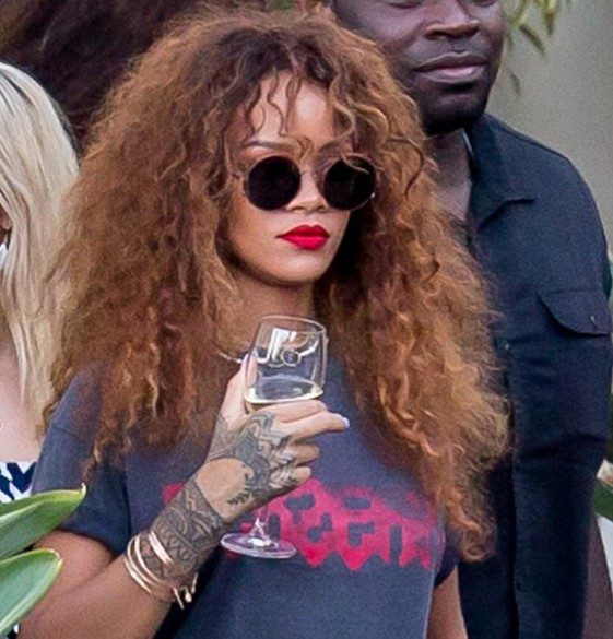 Rihanna downs a glass of wine during a lunch date in Malibu photo