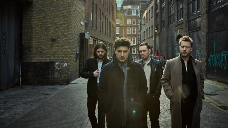 Mumford and Sons get festival ready with tequila and a hug photo