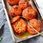 Saffron risotto stuffed tomatoes photo