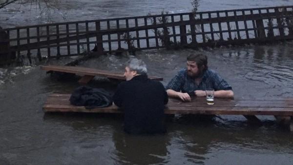Leeds pub garden floods, men go for pint anyway photo