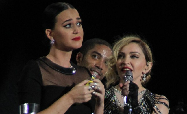 Katy Perry shares a drink with Madonna on stage photo