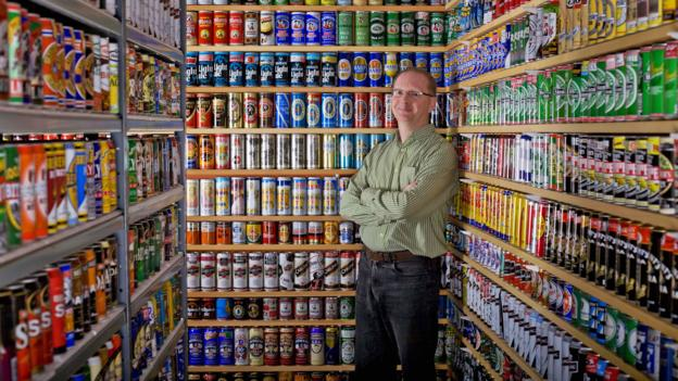 This guy`s empty beer can collection is worth a whopping $1.6 million photo