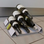How to make a fancy wine bottle display with a cardboard box photo