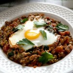 Baked Eggs in Tomatoes with Lentils and Whipped Goat Cheese photo