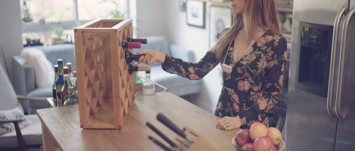 Check out this wine rack that uses an optical illusion to partially hide stored bottles photo