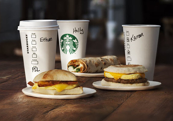 One day after unveiling wage hike, Starbucks raises drink prices photo