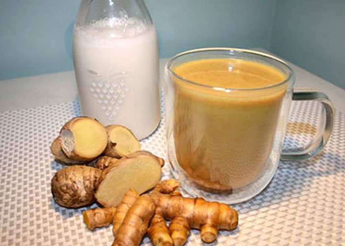 Blend Turmeric and Ginger With Coconut Milk. Drink Before Bed To Flush Liver Toxins While You Sleep photo