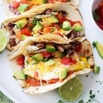 Huevos Rancheros Breakfast Tacos with a glass of Sauvignon Blanc photo