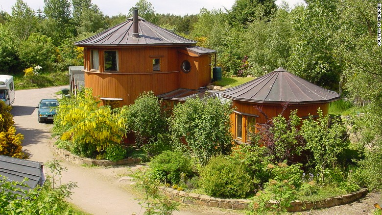 The Houses at this Eco Village are made from Whisky Vats photo