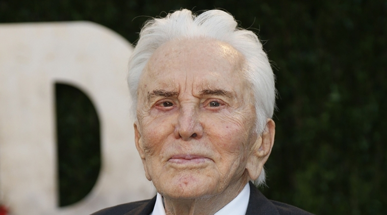 Kirk Douglas celebrates his 100th Birthday with a shot of Vodka photo