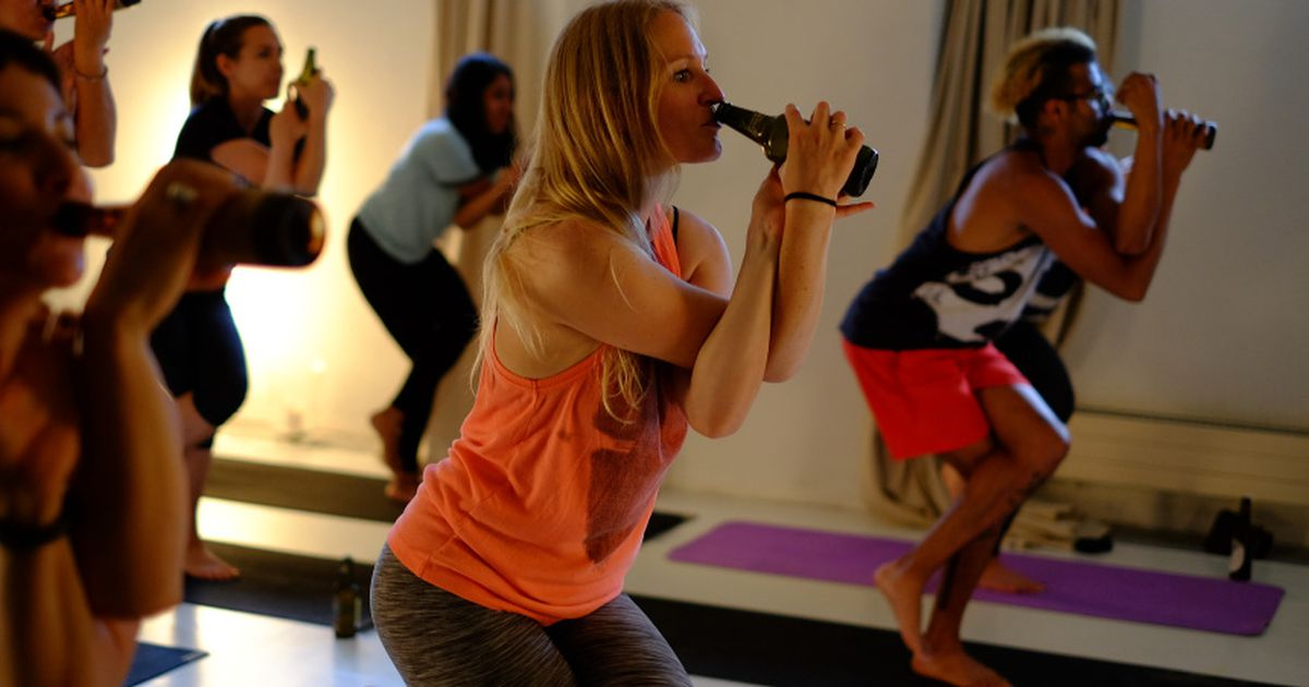 Beer yoga is a thing, now, and it's going international photo