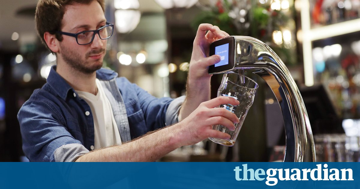 London bar installs world's first tap-and-pay beer pump photo