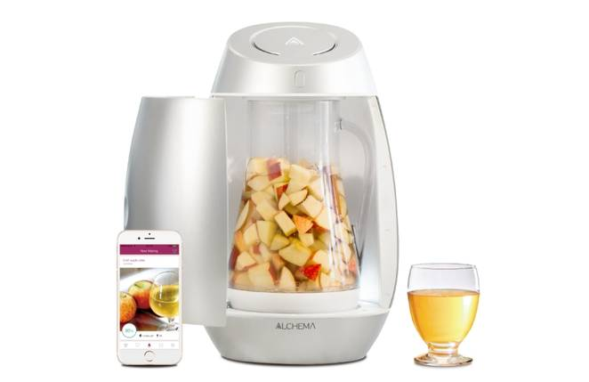 Automated home fermentation device turns fruit into wine or cider photo