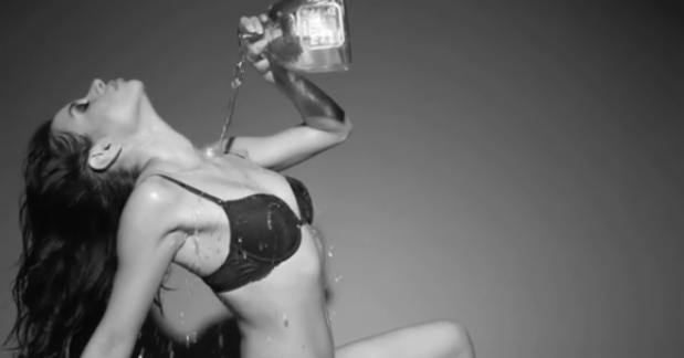Super Model takes sensual Tequila Shower with a bottle of Patron photo