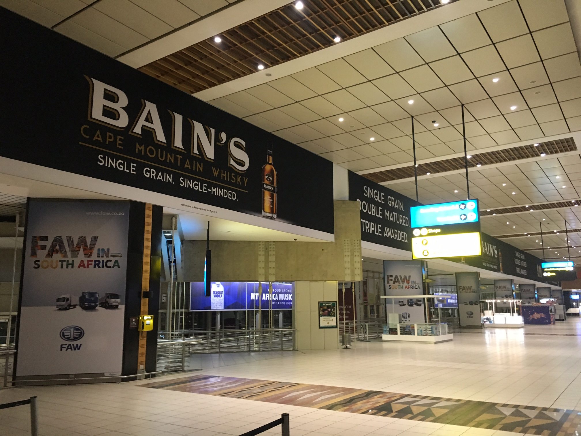 Airport Ads serves up Bain's Single Grain Whisky in Cape Town and Johannesburg photo