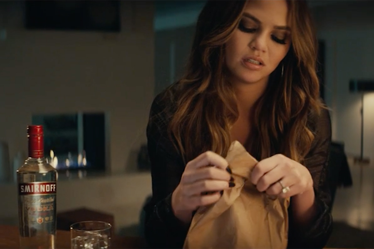 Chrissy Teigen Devours A Burrito In Smirnoff's Latest Brand Push photo