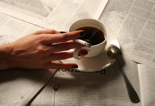 The reason why smokers drink more coffee photo