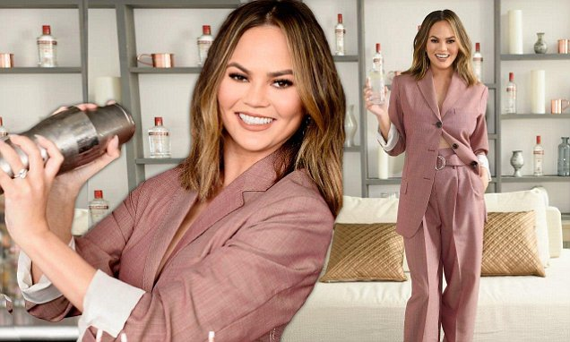 Chrissy Teigen Suits Up For Smirnoff Event photo