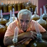 Winemaker uses condoms and tropical fruit to make wine photo