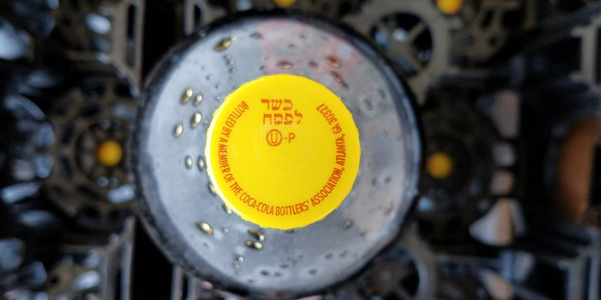 Here's Why Some Coca-cola Bottles Have A Yellow Cap photo