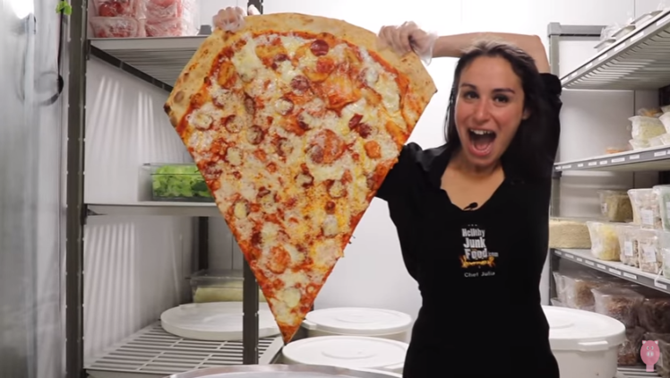 This Couple Has Created The Largest Pizza Slice You've Ever Seen photo